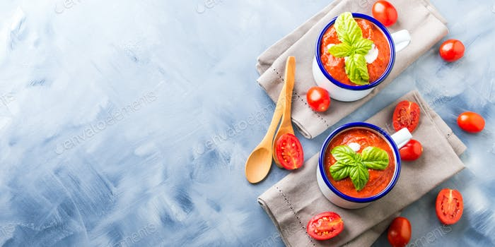 Tomato soup in enamel mugs