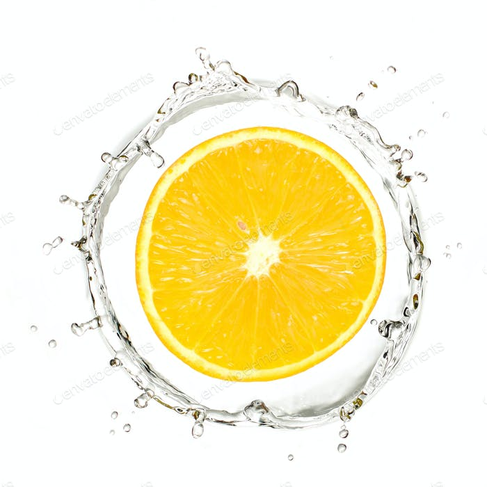 Yellow mandarin or orange in water splash