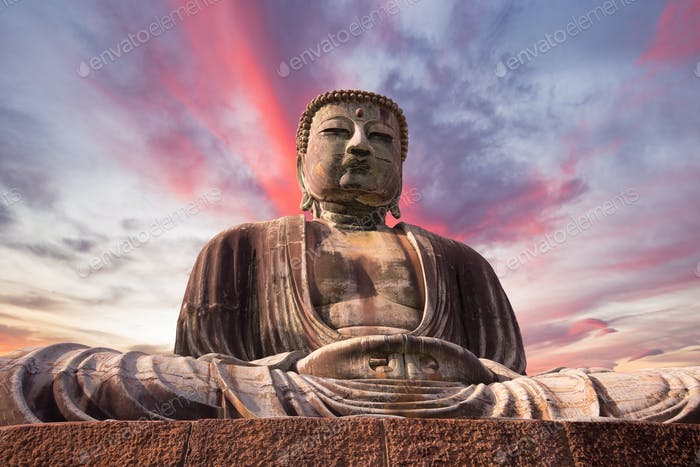 Giant Buddha statue under at sunset