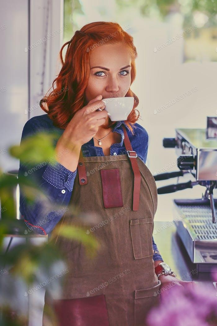 Female barista in a small coffee shop.