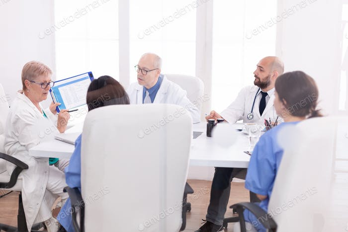Medical staff gathered in conference room