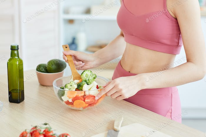 Young Woman Cooking Healthy Salad