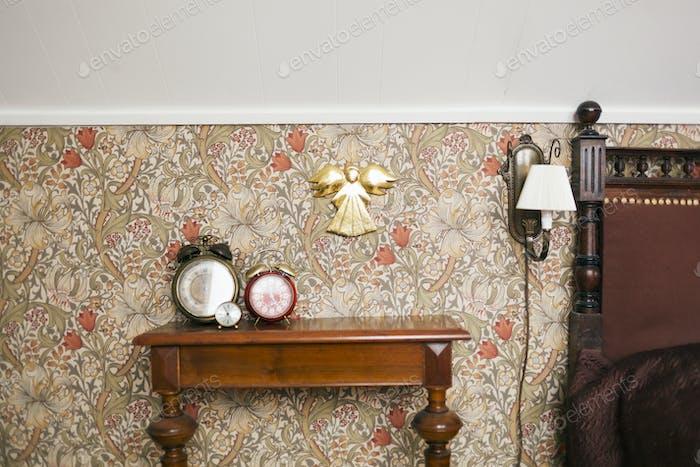 Alarm clocks on sideboard