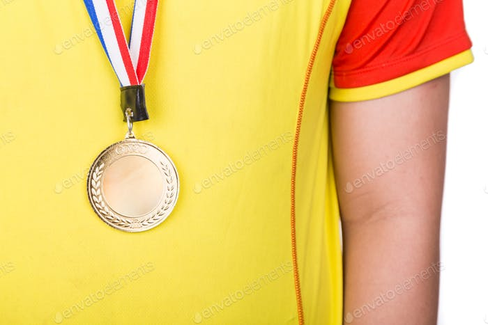 Athlete wearing generic gold medal with ribbon on his neck