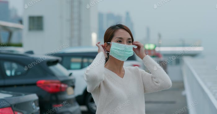 Woman wear medical face mask at street