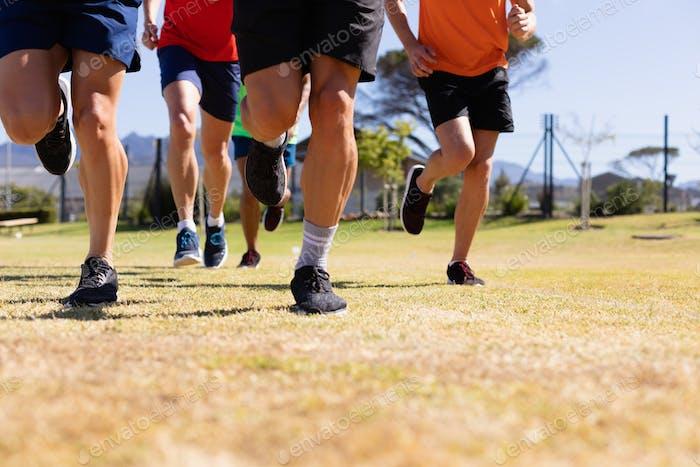Men running to train