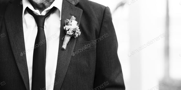 Mature groom getting married at the beach