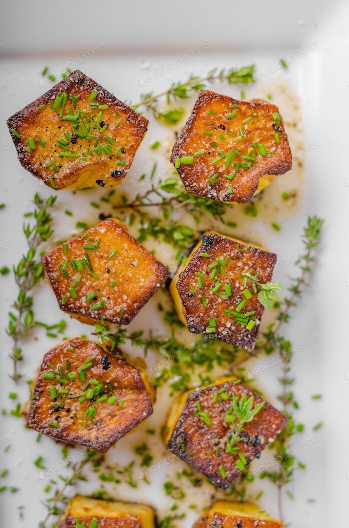 Potato fondant with garlic and herbs