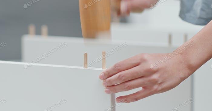 Woman assembling a white shelf