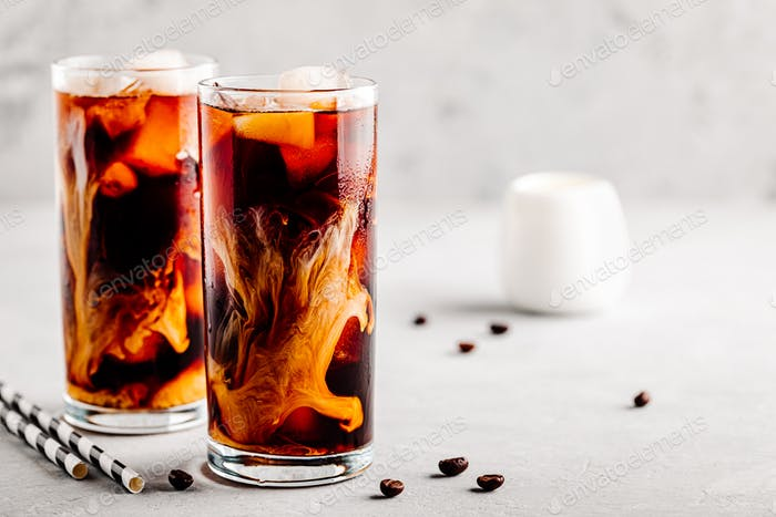 Coconut chai iced coffee with ice cubes in tall glasses