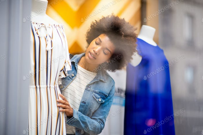 beautiful young African american woman shopping for clothes