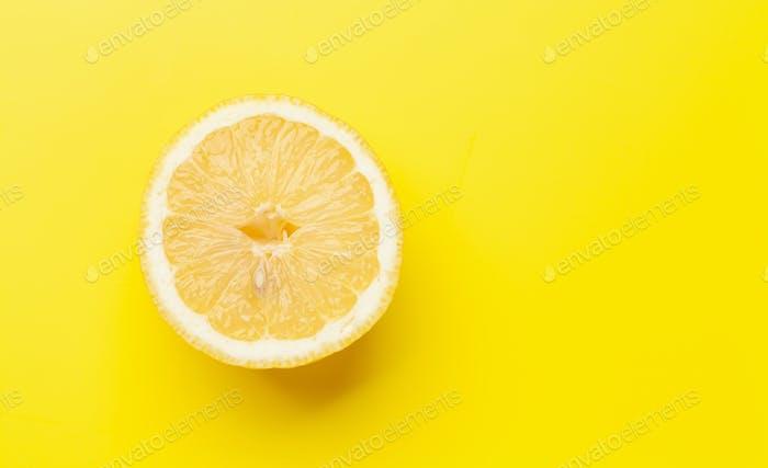 Fresh ripe lemon on yellow background