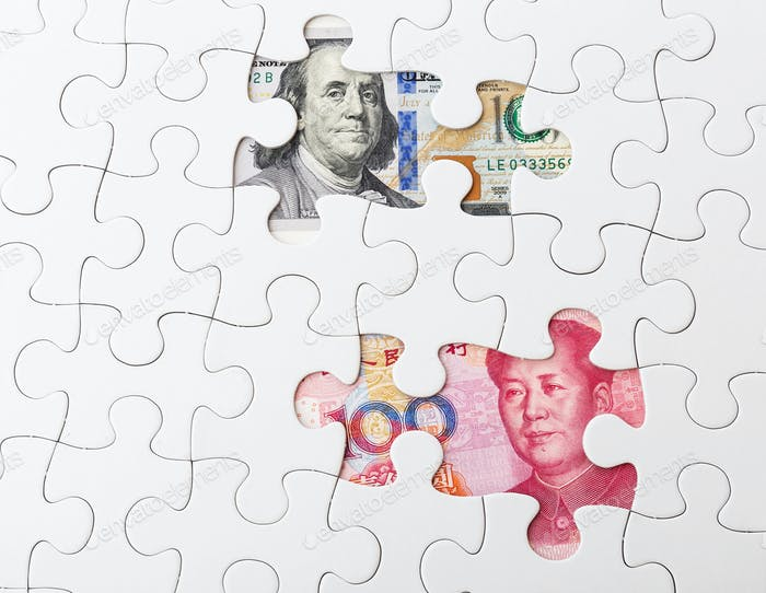 White puzzle with US and chinese banknote