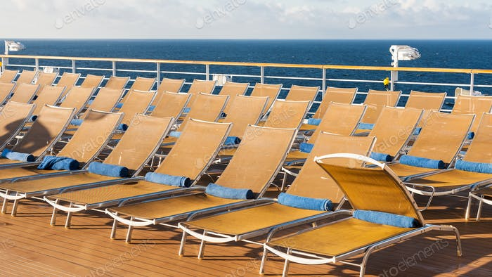 chairs in relaxation area on stern of cruise liner