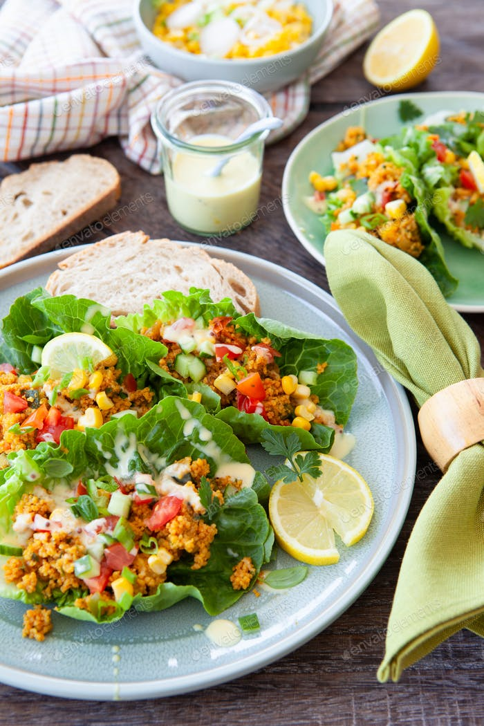 Fresh lettuce with couscous and vegetables
