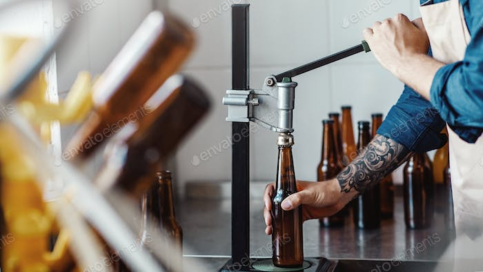 Lager bottles on modern plant, beer business, drink manufacturing and modern factory