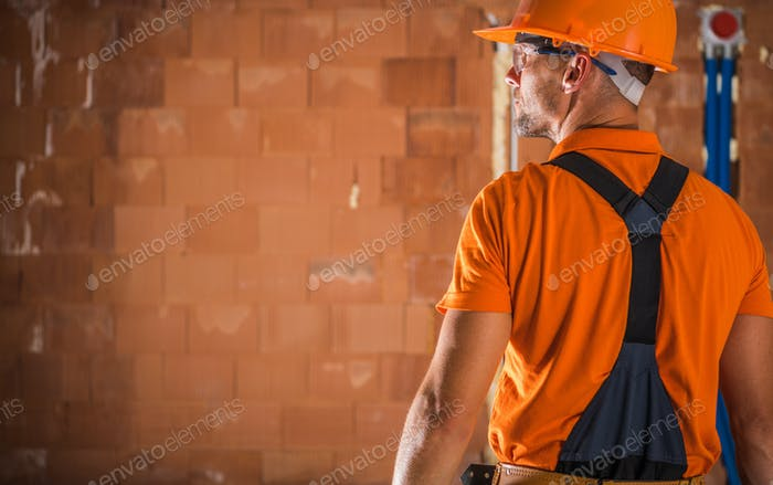 Construction Industry Worker in Orange Hard Hat and Tshirt