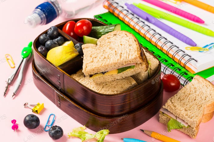 School wooden lunch box with sandwiches