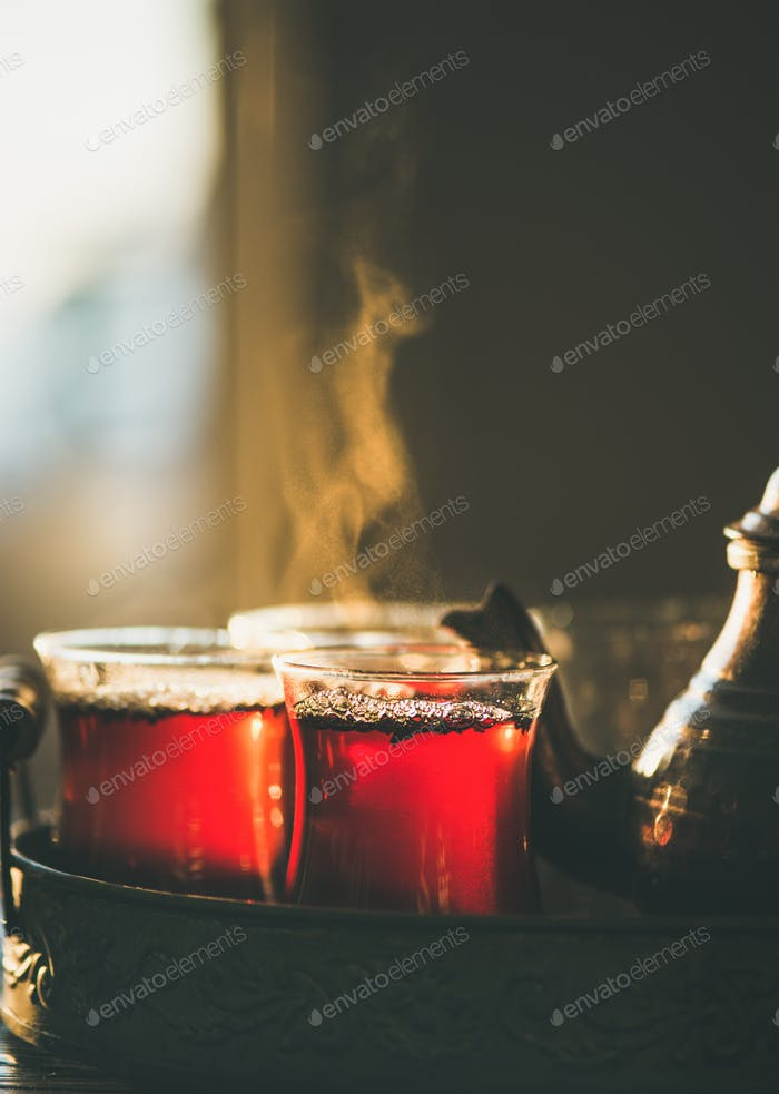 Freshly brewed black tea in turkish glasses , close-up