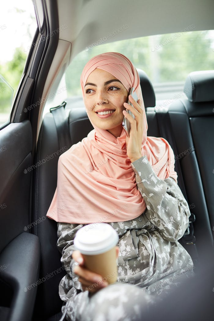 Confident Muslim woman talking on phone