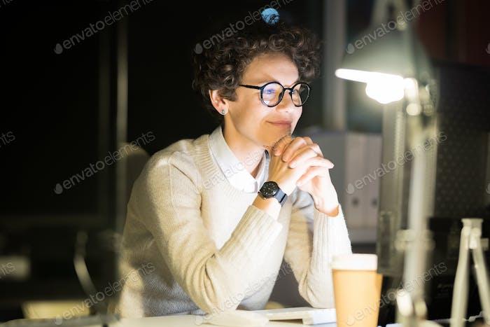 Smiling Woman Watching Video