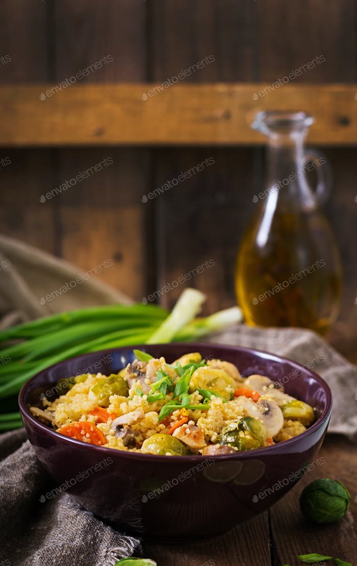 Dsc Vegetarian couscous salad with brussels sprouts, mushrooms, carrots and spices