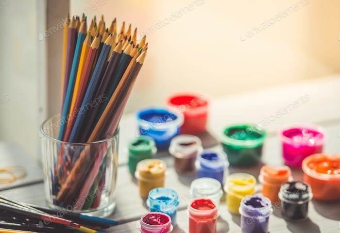 Colored pencils and paint