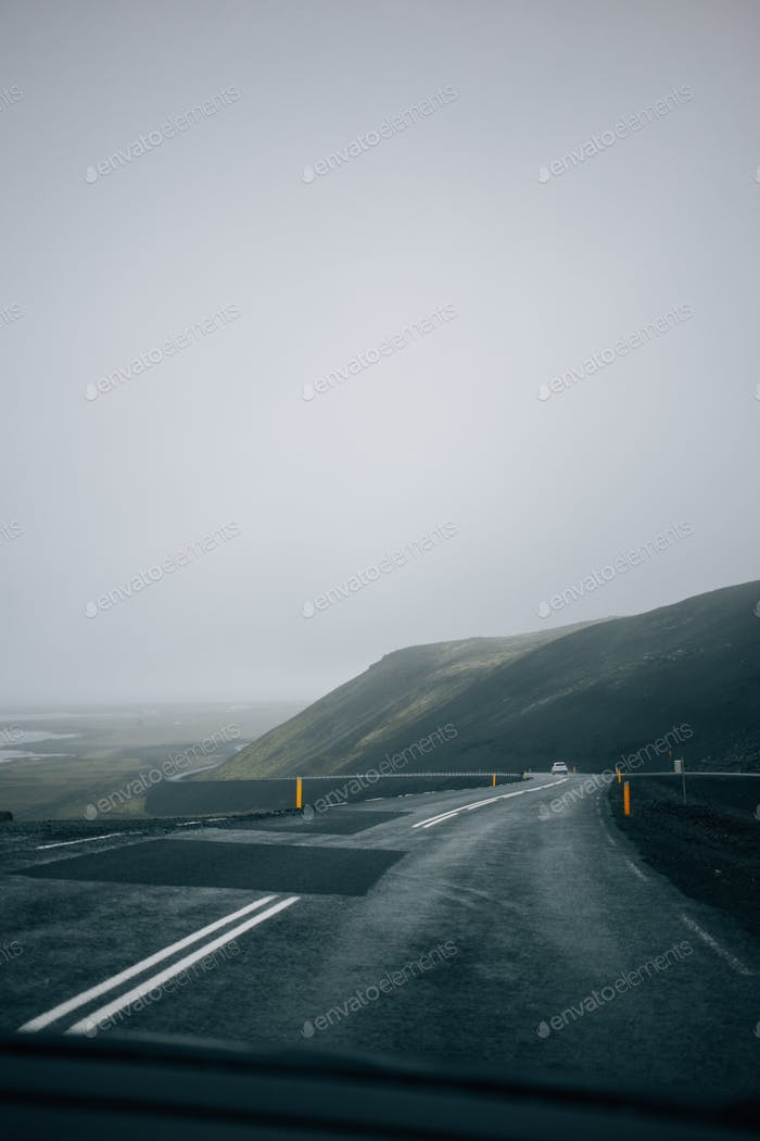 Empty rainy iceland road in clouds