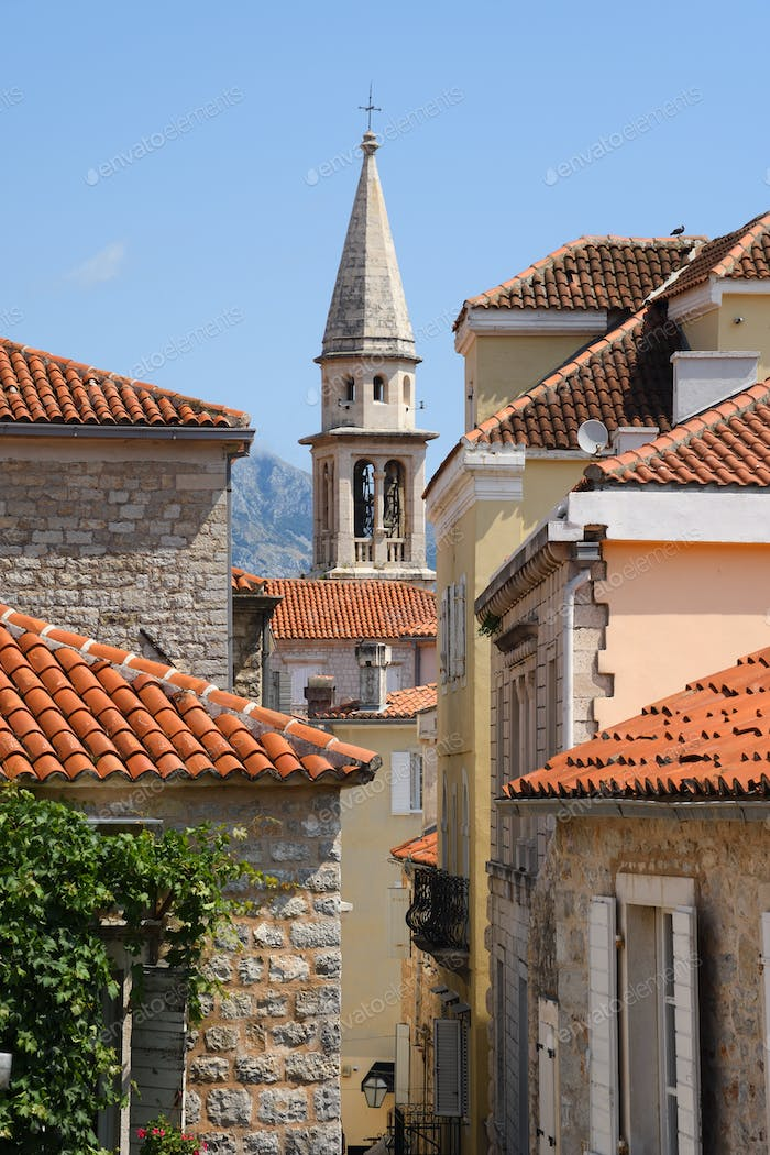 Bell tower and buildings in old town of Budva, Montenegro