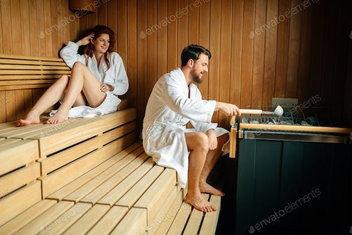 Couple enjoying finnish sauna
