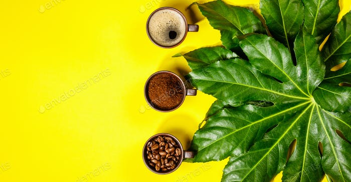Coffee composition on yellow background, flat lay