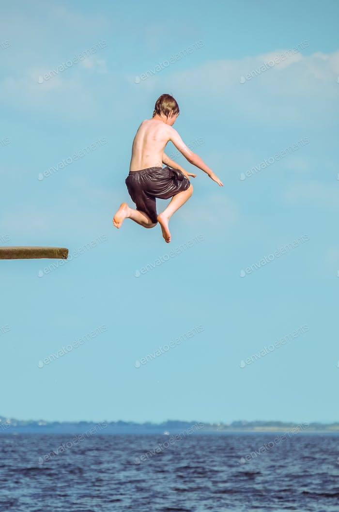 Irish boy jumps into ocean from the ramp in Galway Ireland