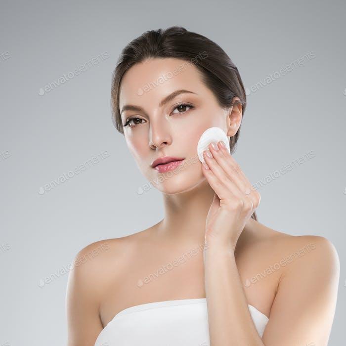 Cotton pad woman face clean skin remove makeup.