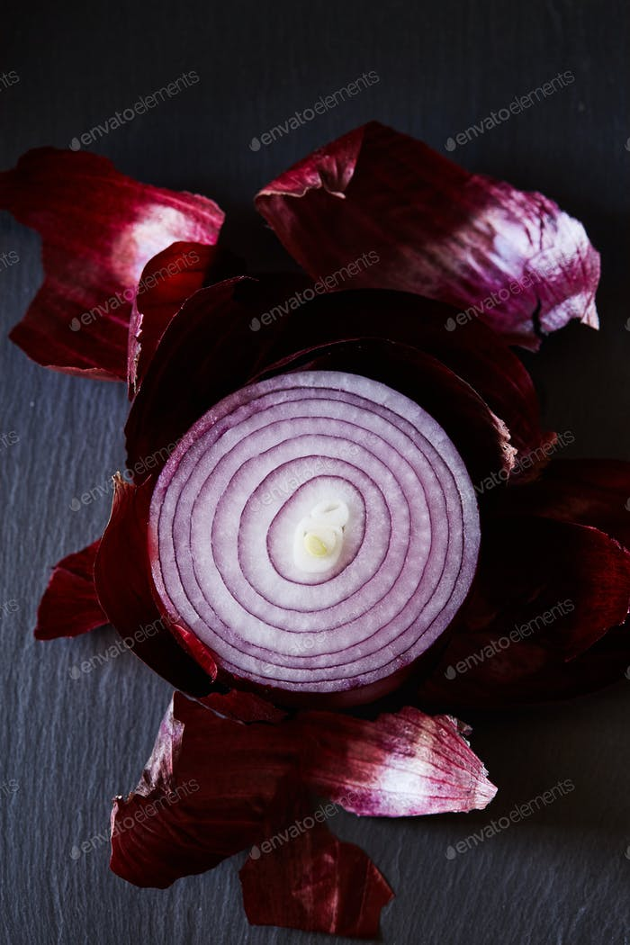 Sliced red spanish onion with peel
