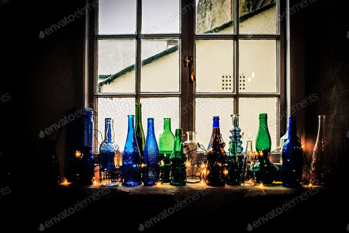 Coloured Bottles on a Window Sill