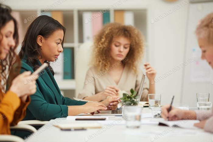 Four Businesswomen Working In Office