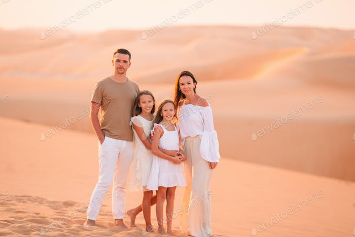 People among dunes in desert in United Arab Emirates