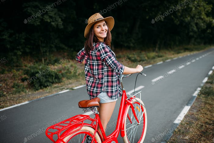 Portrait of pretty woman with red vintage bicycle