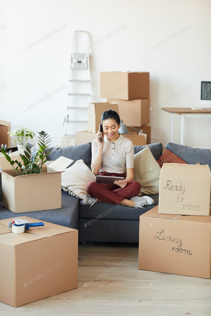 Young Asian Woman Calling Moving Services