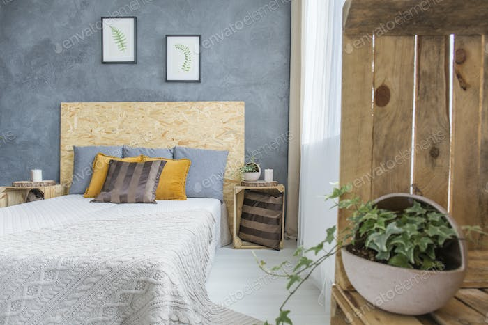 Wooden and concrete bedroom