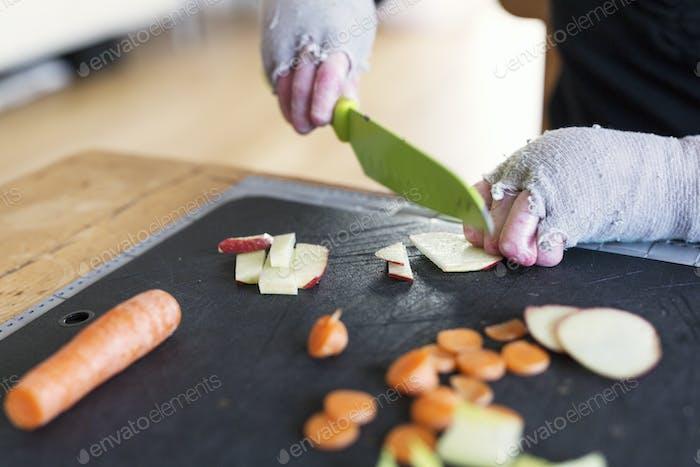 Disabled woman preparing food