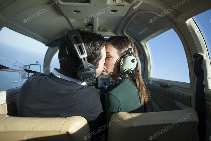 Young pilot and girlfriend
