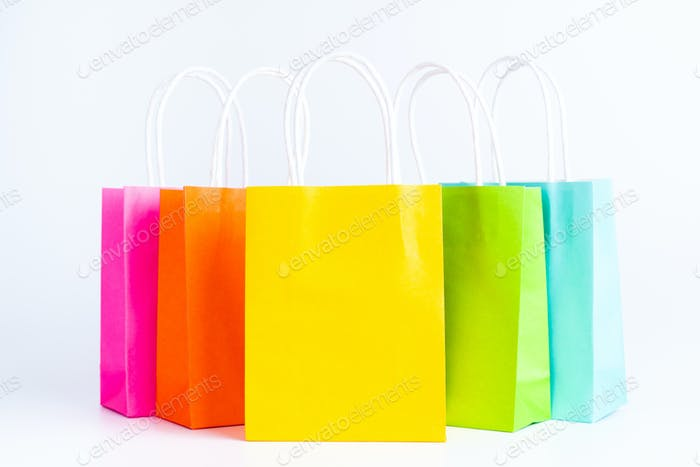 Colorful shopping bags standing in a row
