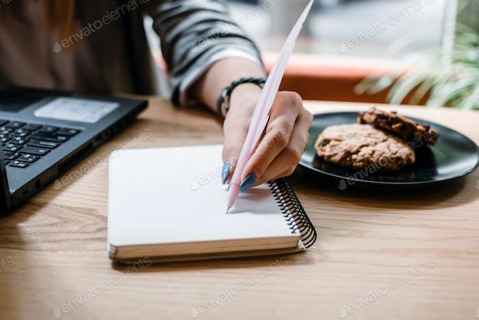 Copywriter, content creator, Remote Copywriting. Young woman freelancer typing on keyboard using