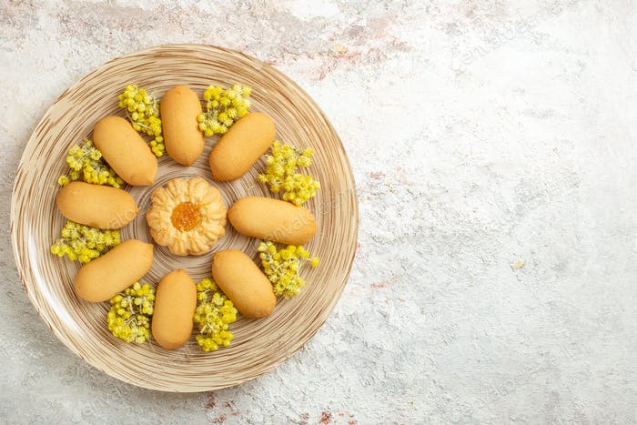 cookie plate with bright yellow flowers on a marble background