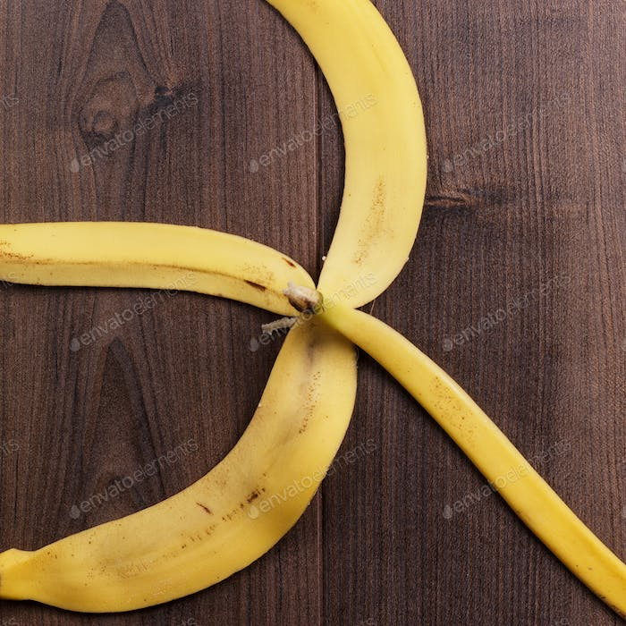 Banana Peel On The Wooden Background
