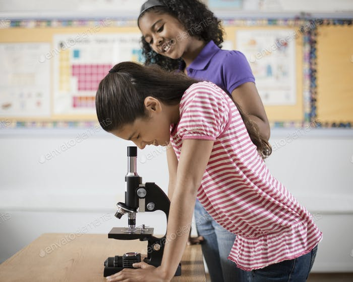 Two children using a microscope.