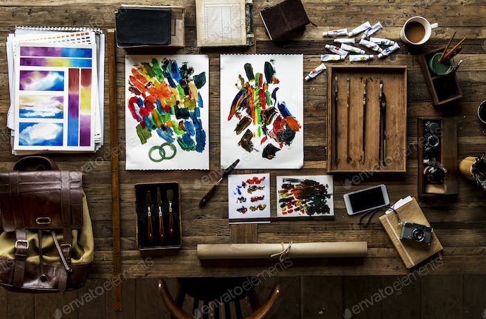 Aerial view of artistic euqipments painting tools on wooden tabl