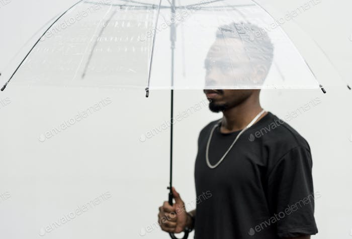 African man using an umbrella