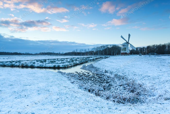 white windmill in winter morning